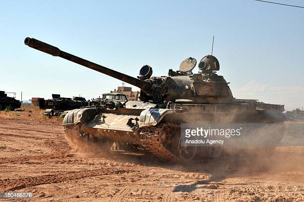 Free Syrian Army member drives a renovated tank at 46th regiment captured by FSA on September 4 2013 near Aleppo Syria FSA members mend and use the...