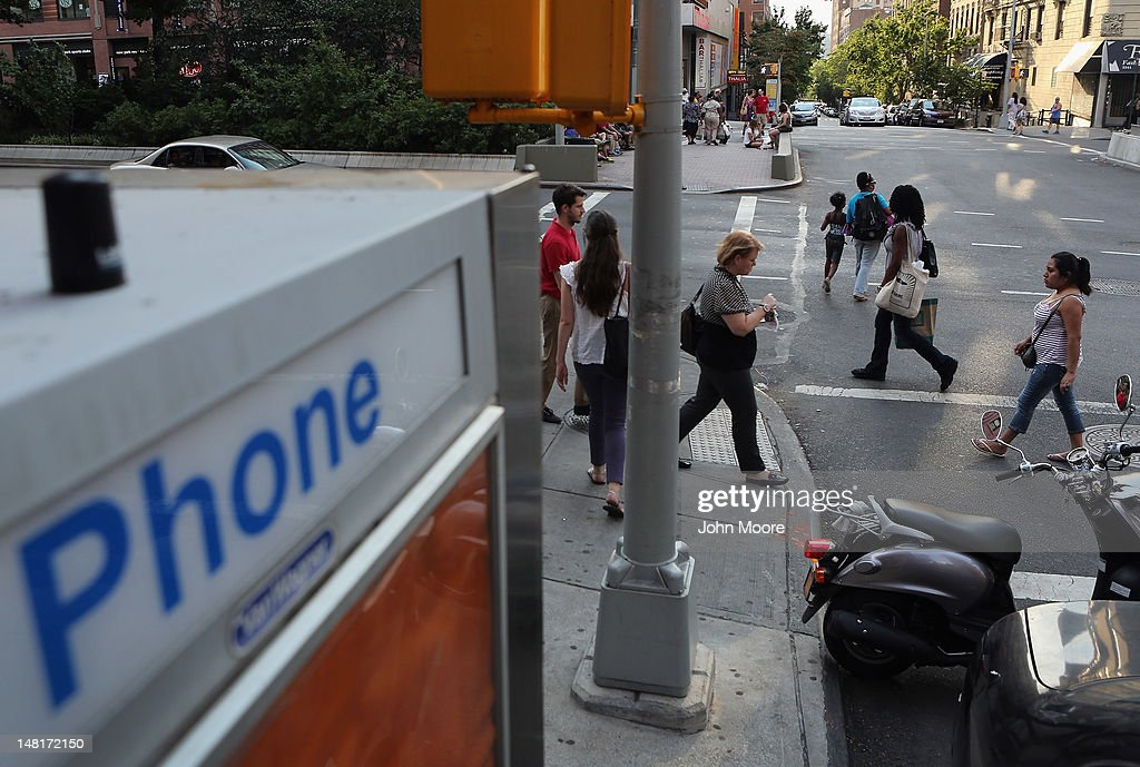 A free Wi-Fi hotspot beams broadband internet from atop a public phone booth on July 11, 2012 in Manhattan, New York City. New York City launched a pilot program Wednesday to provide free public Wi-Fi at public phone booths around the five boroughs. The first ten booths were lit up with Wi-Fi routers attached to the top of existing phone booths, with six booths in Manhattan, two in Brooklyn, and one in Queens. Additional locations, including ones in the Bronx and Staten Island, are to be added soon.