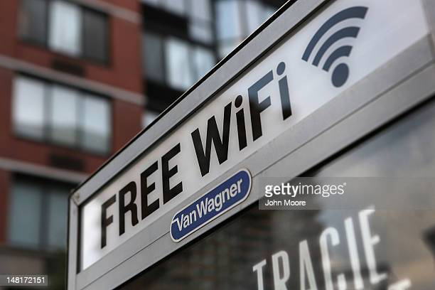 A free WiFi hotspot beams broadband internet from atop a public phone booth on July 11 2012 in Manhattan New York City New York City launched a pilot...