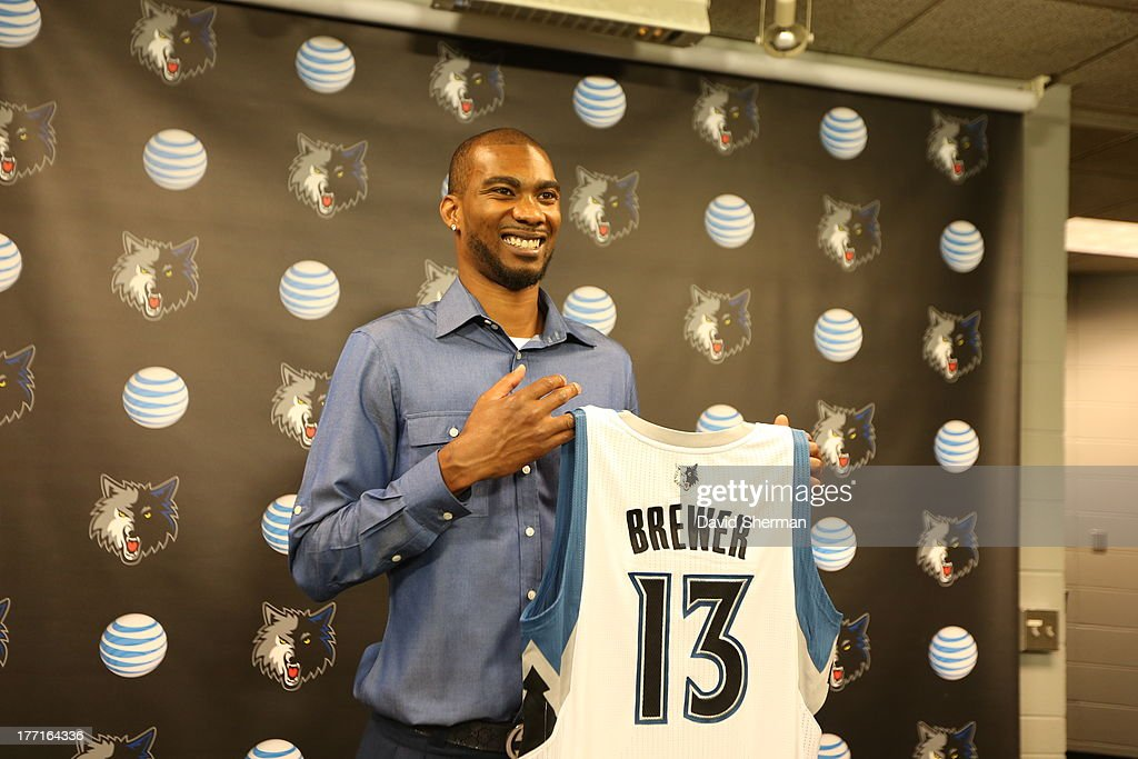 Free-agent acquisition Corey Brewer of the Minnesota Timberwolves shows his new jersey to the media on August 21, 2013 at Target Center in Minneapolis, Minnesota.