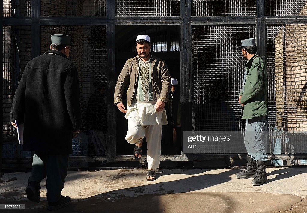 A freed Afghan prisoner leaves the main prison in Herat on February 6, 2013. Seventy five prisoners, including fourteen women, were released as part of an amnesty decreed by Afghanistan President Hamid Karzai on the occasion of Eid-e-Milad-un-Nabi, the birthday of the prophet. AFP PHOTO/Aref KARIMI