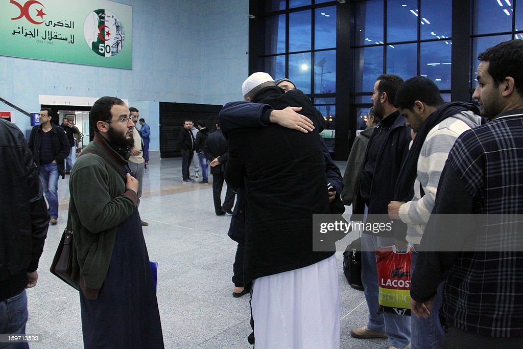 A freed Algerian hostage hugs a relative at Algiers airport after he was released by Islamist captors, alongside other Algerian hostages, from a gas plant in In Amenas, more than 1,600 kilometres from the capital, on January 18, 2013. More than 72 hours after the heavily armed militants staged a deadly raid on the complex, and two days after Algerian special forces launched a botched rescue bid widely condemned as hasty, there appeared to be a stand-off in the Sahara. AFP PHOTO /STR