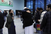 A freed Algerian hostage hugs a relative at Algiers airport after he was released by Islamist captors alongside other Algerian hostages from a gas...