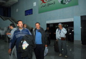 Freed Algerian hostages arrive at Algiers airport after they were released by Islamist captors alongside other Algerians from a gas plant in In...