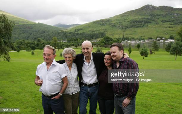 Freed BBC journalist Alan Johnston is reunited with family members sister Katriona brotherinlaw Raymond Hogg and parents Graham and Margaret at...