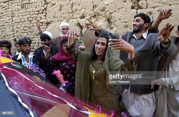 lifting over head stock photos and pictures getty images d from the oppresive restrictions of the taliban afghan women sing and dance in public during