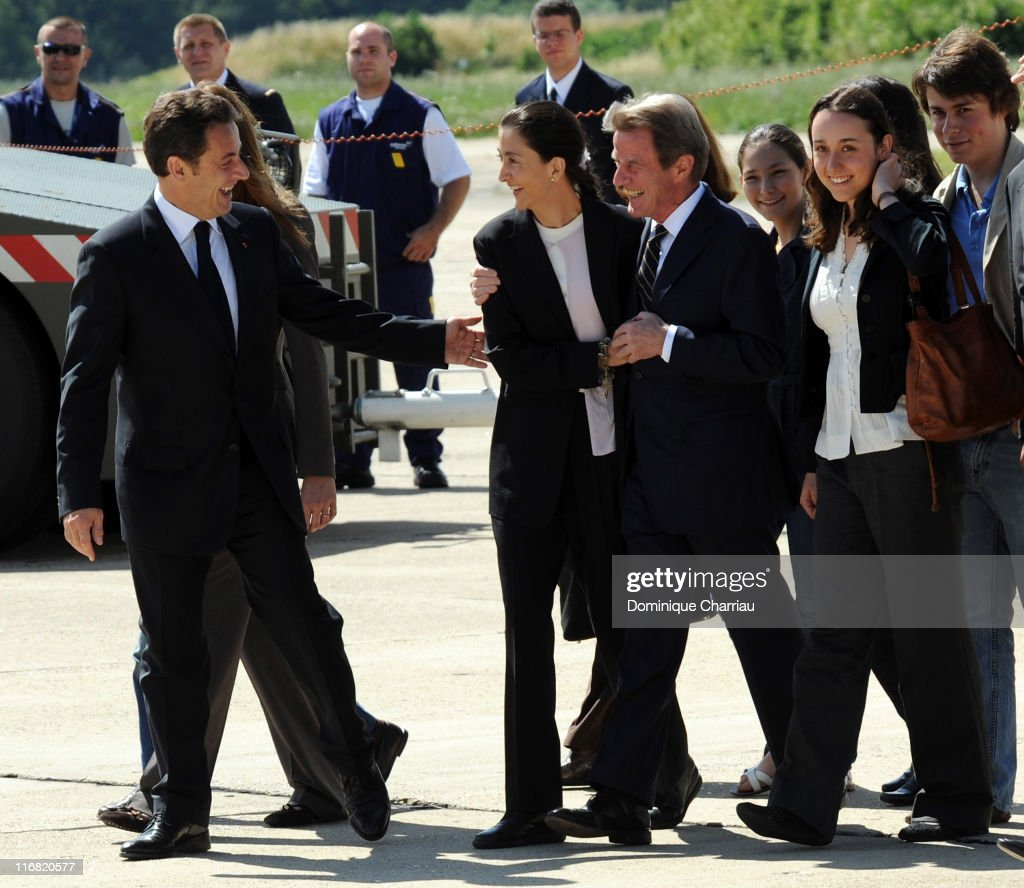 Freed hostage Ingrid Betancourt (R) is accompanied by French president Nicolas Sarkozy and Bernard Kouchner on her arrival at the military base of Villacoublay on July 4, 2008 in Velizy Villacoublay, France.