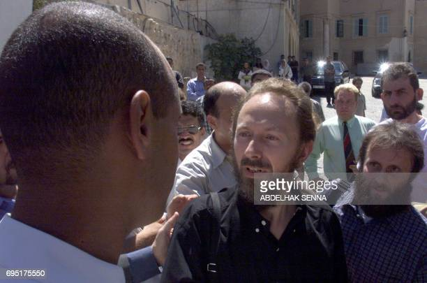 Freed hostages Seppo Fraenti of Finland compatriot Risto Vahanen and French Stephane Loisy are greeted 12 September 2000 in Tripoli by Seif alIslam...