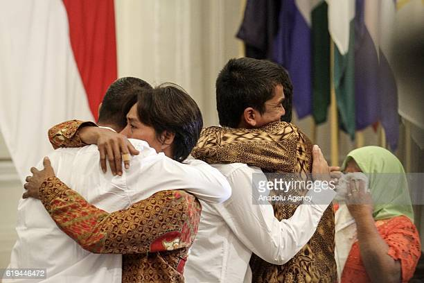 Freed Indonesians who were held hostage for nearly five years by Somali pirates reunite with family members at the Foreign Ministry office in Jakarta...