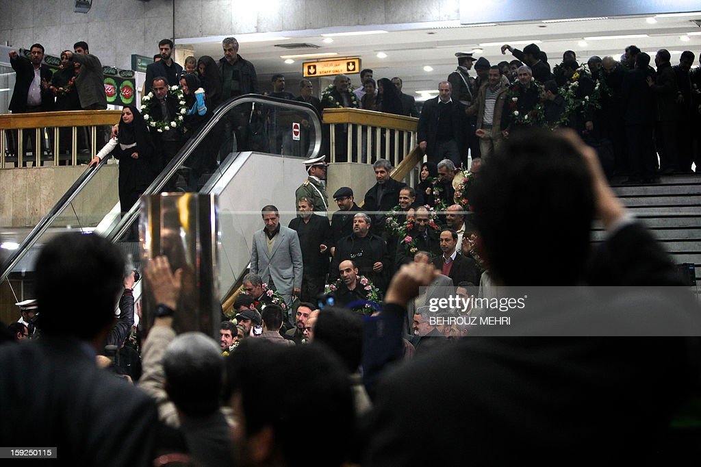 Freed Iranians who have been held hostage by Syrian rebels by Syrian rebels since early August 2012, arrive at Tehran's Mehrabad airport on January 10, 2013. The rebels agreed to swap the 48 Iranians, described by the Islamic republic as pilgrims but by the rebels and Washington as members of Iran's elite Revolutionary Guards, for more than 2,000 detainees held by the Syrian regime. AFP PHOTO / BEHROUZ MEHRI