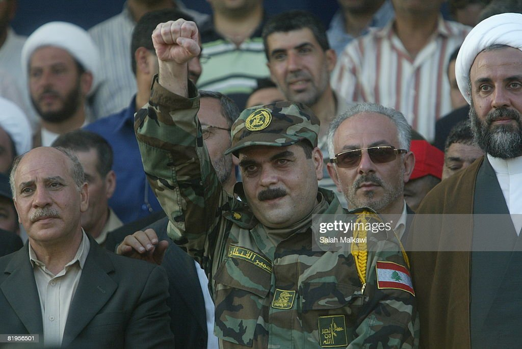 Freed Lebanese prisoner Samir Qantar greets the crowd upon his arrival from an Israeli prison as Hezbollah prepare to receive the bodies of 200 soldiers, during an exchange of prisoners with Israel on July 16, 2008 in Naqoura, Lebanon. Israel returned five Lebanese prisoners and the bodies of 200 Lebanese and Palestinian fighters in return for the bodies of the two Israeli soldiers, who's capture sparked the war of 2006. The exchange was engineered by the Red Cross.