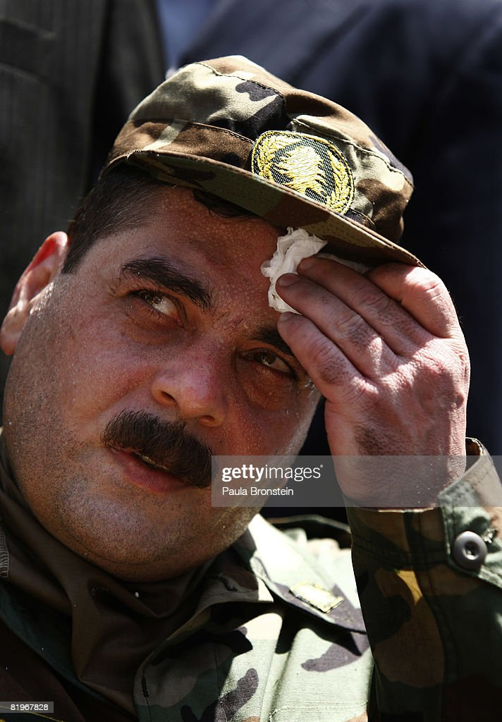 Freed Lebanese prisoner Samir Qantar wipes the sweat from his brow during a celebration for him July 17, 2008 in his mountain village of Aabay, outside of Beirut, Lebanon. Kantar was the most controversial prisoner released from Israel in a prisoner exchange agreement between Israel and Lebanon. Kantar was jailed for 29 years after being sentenced to five life terms for a triple murder in 1979. The agreement between Israel and Lebanon allowed Israel to receive the bodies of two Israeli soldiers who were seized two years ago. The other four freed Hezbollah fighters were captured in the 2006 war, the 5 released were the last remaining Lebanese prisoners in Israeli jails.