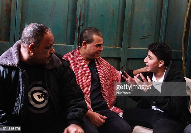 A freed Palestinian prisoner Amr Masoud center sits with relatives and friends at his family's house in AlShatea refugee camp in Gaza City on 30...