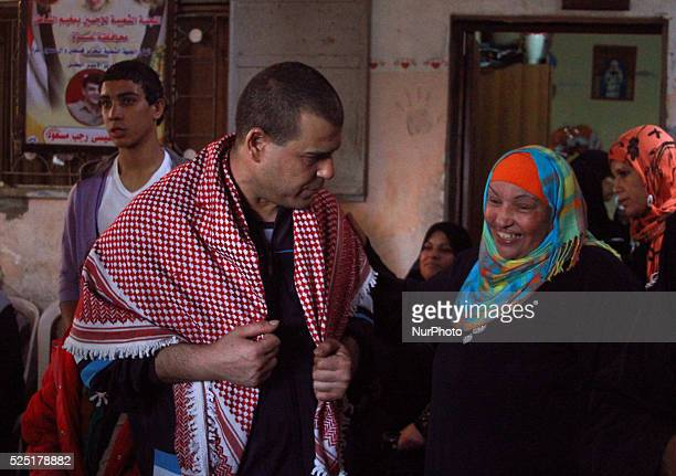 A freed Palestinian prisoner Amr Masoud Left with relatives and friends at his family's house in AlShatea refugee camp in Gaza City on 30 October...