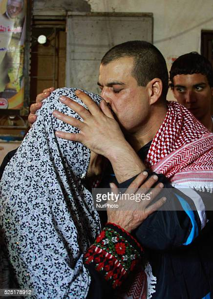 A freed Palestinian prisoner Amr Masoud with his mother at his family house in AlShatea refugee camp in Gaza City on 30 October 2013 'Masoud' who was...
