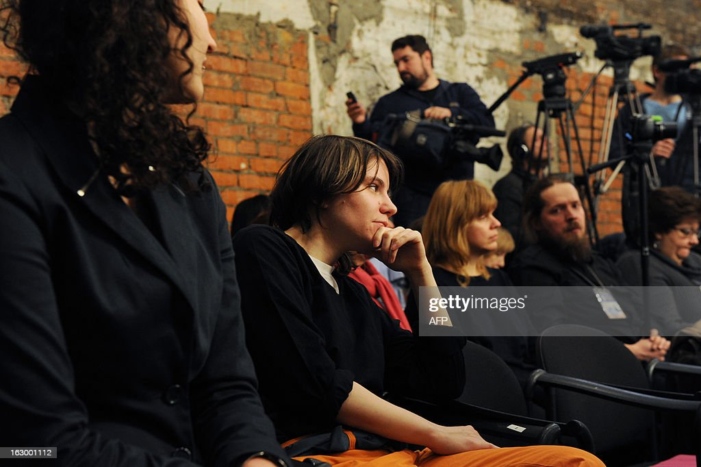 Freed Pussy Riot punk Yekaterina Samutsevich (2nd L) attends the political play 'The Moscow Trials' staged by director Milo Rau in Sakharov Centre in Moscow, on March 3, 2013. Russian migration officials disrupted a Moscow play by a Swiss director about the trial against punk band Pussy Riot today, while religious activists caused a commotion outside. AFP PHOTO / ADNREY SMIRNOV