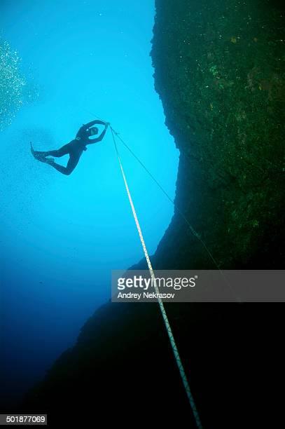 Freediver descending to a cave, Mediterranean Sea, Kas, Kas, Turkey