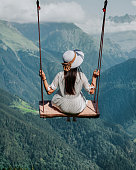 Freedom and carefree of a young female on a swing.