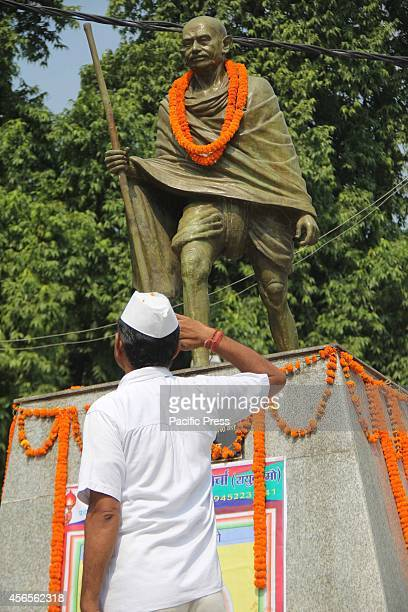 A freedom fighter salutes to Indian leader Mohandas Karamchand Gandhi on his 145th birth anniversary at Allahabad