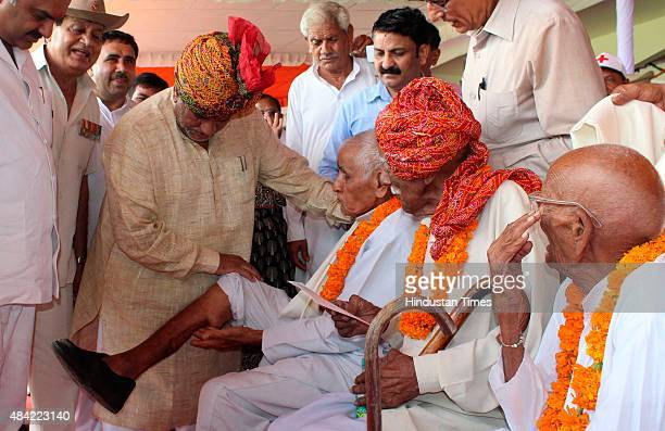 A freedom fighter showing his leg to Krishan Lal Panwar Haryana Transport Housing Minister on the occasion of 69th Independence Day celebration at...