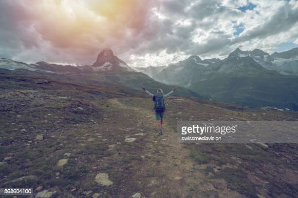 Freedom in nature, young woman enjoys hiking - Switzerland