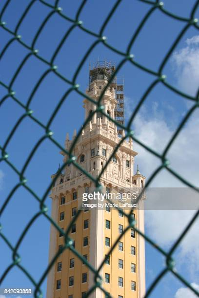 Freedom Tower in Miami behind chainlink fence