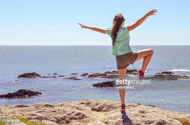 Freedom. Woman w/ arms and leg raised like a bird