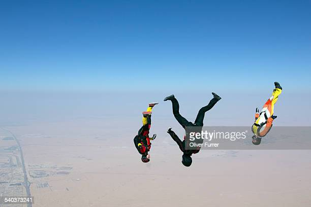 Freefly jumpers diving together headover