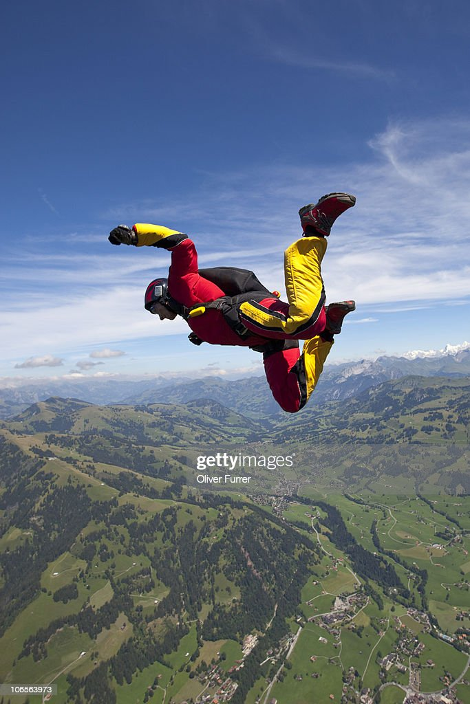 Freefly skydiver is playing high in the sky. : Stock Photo
