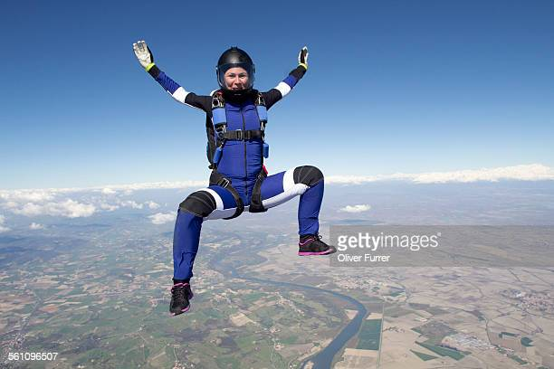 Freeflying skydiver in blue sky