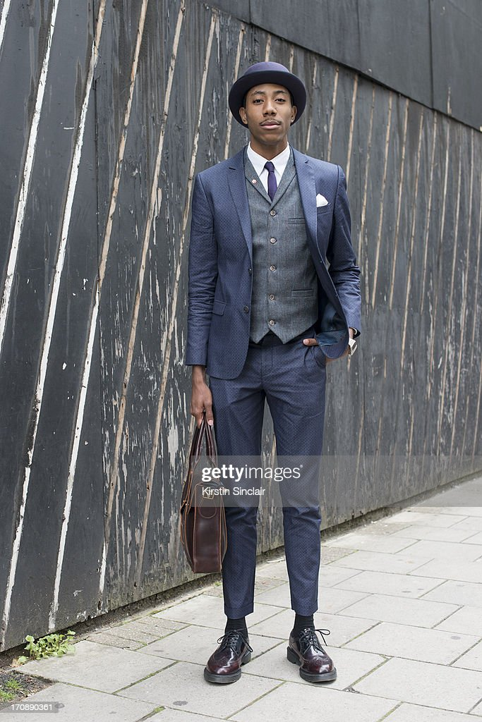 Freelance brand consultant LaTouche wears Doc Martens shoes and bag, Lacoste shirt, River Island suit and waistcoat, Top Man tie and Atelier Millinery hat on day 1 of London Collections: Men on June 16, 2013 in London, England.