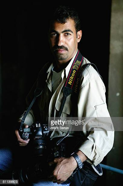 Freelance Iraqi photographer Wathiq Khuzaie working for Getty Images poses for a photograph June 30 2004 in Baghdad Iraq Khuzaie has been working as...