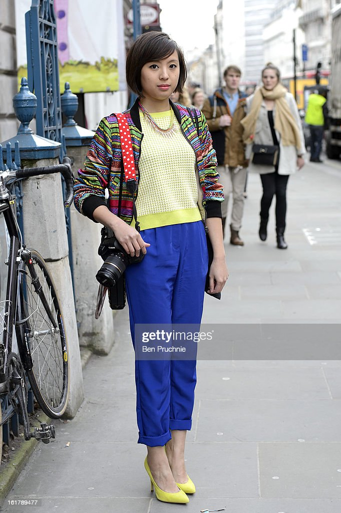 Freelance retail designer Rosie (27) poses wearing Topshop shoes, American Apparel trousers, Top Shop top, H+M jacket with a necklace from New Look outside the John Rocha catwalk show at Somerset House during London Fashion Week F/W 2013 on February 16, 2013 in London, England.