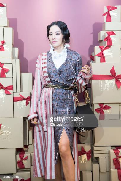 freelance stylist and style influencer tina leung poses for a photograph on the red carpet at - Freelance Stylist