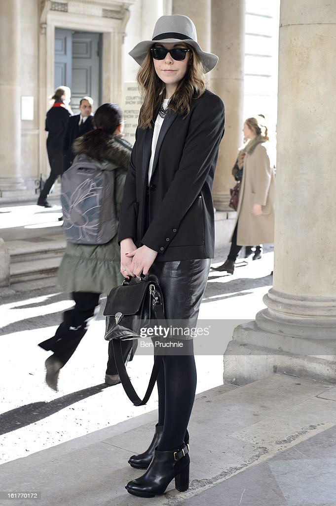 Freelance stylist Camilla (24) poses wearing an Allesandro jacket, Mau necklace, Vintage shirt and bag with Ray Ban sunglasses 2squared hat and Top Shop Shoes at the KTZ London Fashion Week F/W 2013 presentation at Somerset House on February 15, 2013 in London, England.
