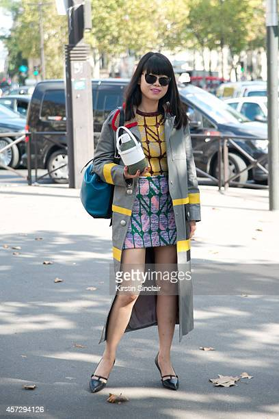 Freelance Stylist Leaf Greener is wearing a Miu Miu dress and Rosie Assoulin bag on day 9 of Paris Collections Women on October 01 2014 in Paris...