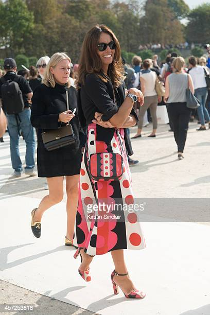 Freelance Stylist Viviana Volpicella is wearing Valentino skirt bag and shoes on day 8 of Paris Collections Women on September 30 2014 in Paris France