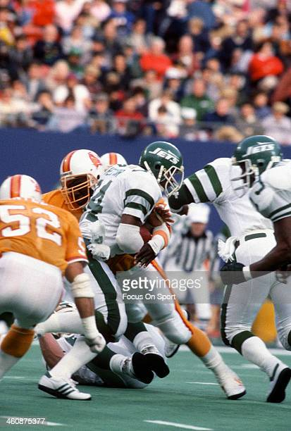 Freeman McNeil of the New York Jets carries the ball against the Tampa Bay Buccaneers during an NFL football game November 17 1985 at The Meadowlands...
