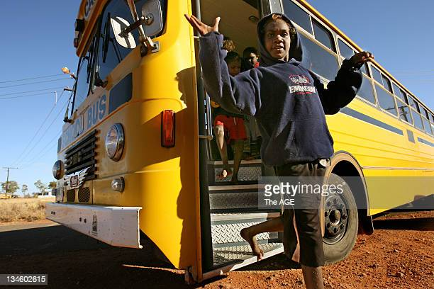 Freena Inkamala jumps off the school bus at Imanpa near Yulara in the Northern Territory Changes to the running of Aboriginal communities by the...