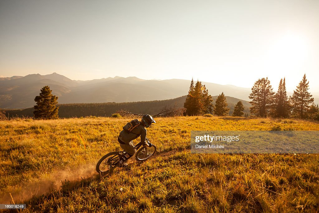 Freeride Biker taking a turn, : Stock Photo