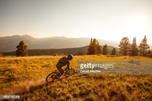 Freeride Biker taking a turn, : Bildbanksbilder