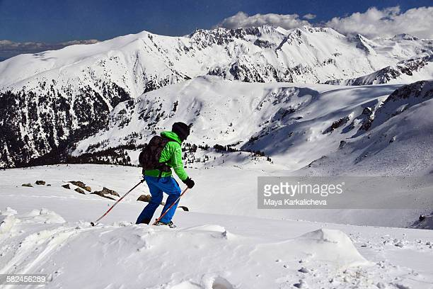 Freeride skier on slope