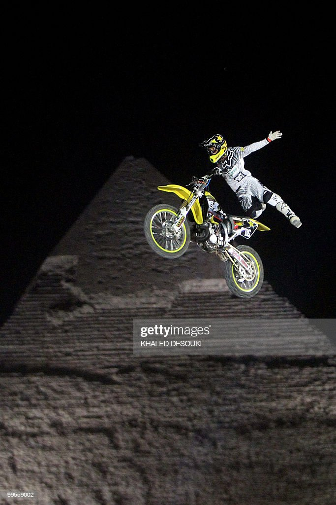 A freestyle biker jumps in front of the Giza pyramids during the second stage of the freestyle motocross Red Bull XFighters World Tour on the...