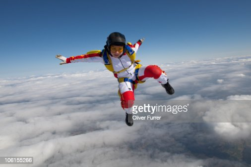Freestyle girl is ballet dancing in the sky. : Stock Photo