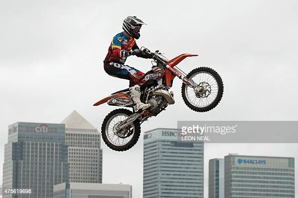 Freestyle motocross rider Steve Sommerfield jumps his KTM motorbike with the financial towers of Canary Wharf in the backgrond in London on June 2...