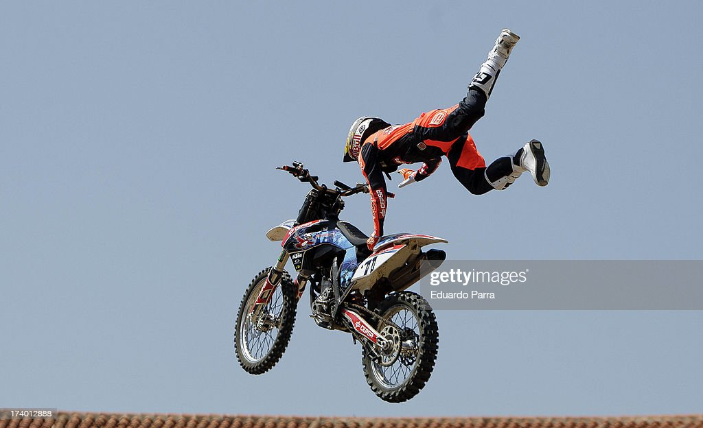 Freestyle motorcycle rider Dany Torres performs a maneuver during the Red Bull XFighters 2013 practice ride at Las Ventas bullring on July 19 2013 in...