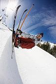 Freestyle Skier Grabbing Edge in Halfpipe