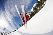 Freestyle Skier Jumping in Halfpipe