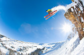 Freestyle skier jumping off cliff