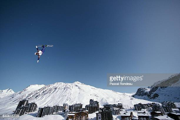 A Freestyle skiing competitor performs an aerial routine during the Freestyle ski event on 13 February 1992 at the XVI Olympic Winter Games in Tignes...